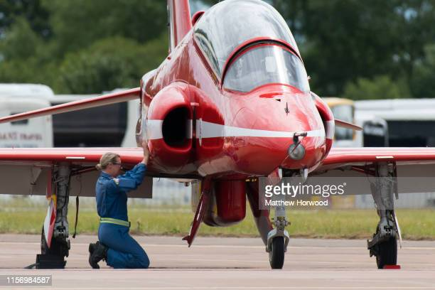 A woman prepares a Red Arrow BAE Hawk aircraft ahead of a display at the the International Air Tattoo at RAF Fairford on July 21 2019 in Fairford...