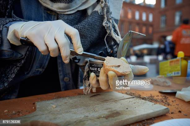 A woman prepares a slice of bread with false 'foie gras' The L214 association did a 'speeddating' about foie gras to have people try false 'foie...