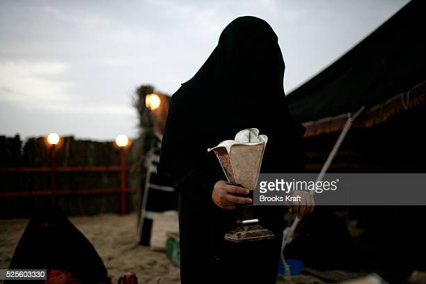 A woman prepares coffee for US President George W Bush's delegation at Abu Dhabi Crown Prince Sheikh Mohammed Bin Zayed Al Nahyan's desert encampment...