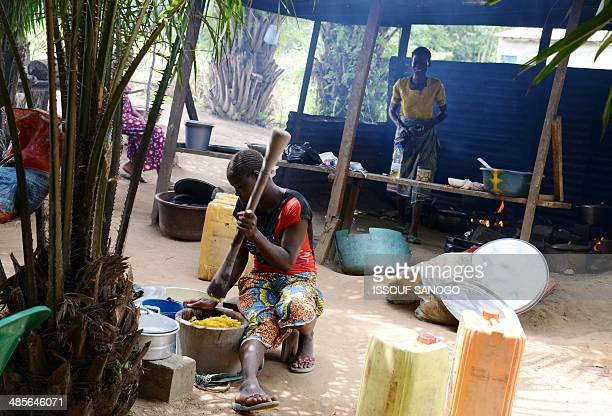 A woman prepares food at a 'maquis' a small African restaurant in Kobakro outside Abidjan which now serves various types of meat instead of bushmeat...