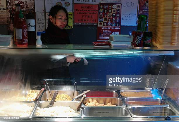 A woman prepares food during the Chinese New Year celebrations to mark The Year of the Rooster on January 29 2017 in Newcastle Upon Tyne United...
