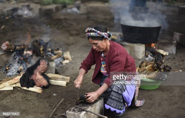 A woman prepares food during the wake of Claudia Gomez a 19yearold Guatemalan woman who was allegedly shot and killed by a US border patrol agent in...