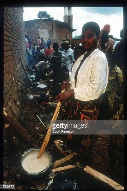 A woman prepares food in a makeshift kitchen April 13 1994 in Kigali Rwanda Following the apparent assassination of Rwandan President Juvenal...