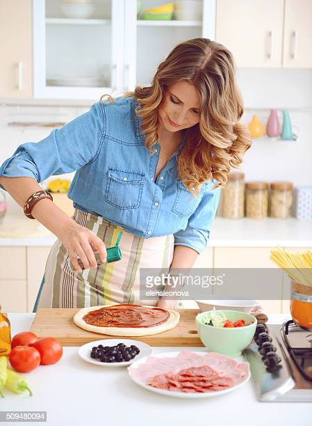 woman prepares food in the kitchen