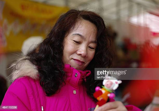 A woman prepares her stall as the Chinese community come together to welcome in the Chinese New Year on February 22 2015 in Newcastle upon Tyne...