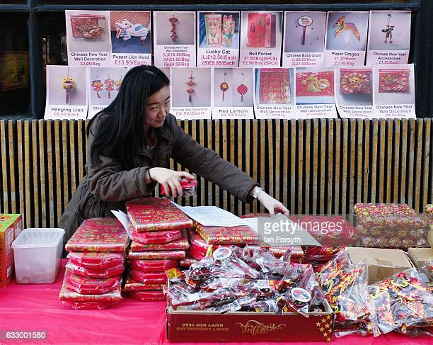 A woman prepares her stall during the Chinese New Year celebrations to mark The Year of the Rooster on January 29 2017 in Newcastle Upon Tyne United...