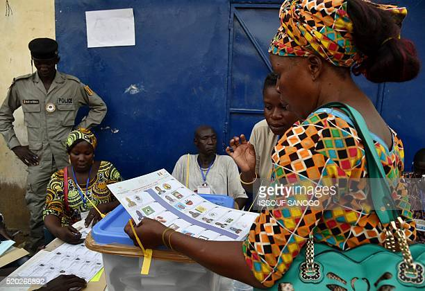 A woman prepares herself to cast her vote at a polling station in the street in N'djamena on April 10 2016 Chadians voted in an election likely to...