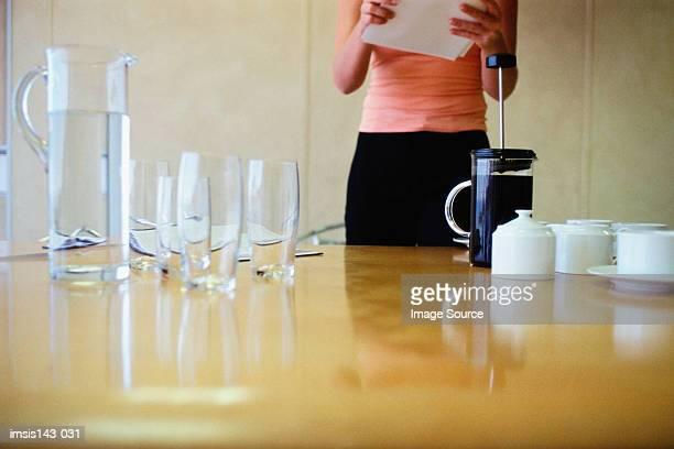 Woman prepares meeting table