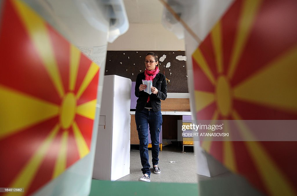 A woman prepares to cast her ballot at a polling station in Skopje on March 24, 2013, as part of the local elections held against a backdrop of ethnic tensions, as a political crisis between the right-wing government majority and left-wing opposition rumbles on.