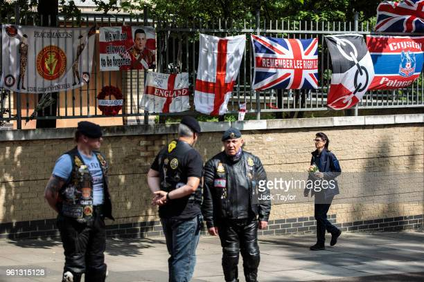 Woman prepares to leave floral tributes at the site of the murder of Fusilier Lee Rigby on the fifth anniversary on May 22, 2018 in London, England....