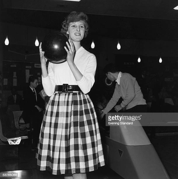 A woman prepares to take her turn at Britain's first ten pin bowling centre in Stamford Hill London 2nd December 1960