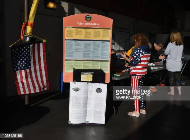 A woman prepares to vote at an Orange County polling station during the midterm elections in Huntington Beach California on November 6 2018 Americans...