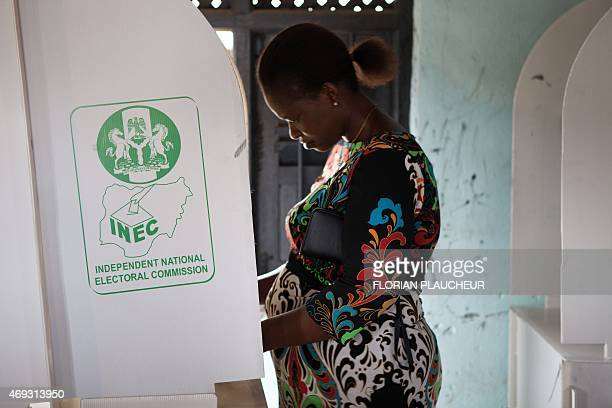 A woman prepares to vote in a polling station of Port Harcourt on April 11 2015 Nigerians were on Saturday voting to choose new state governors and...