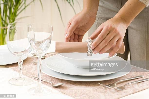 woman preparing a dinner table - arranging stock pictures, royalty-free photos & images