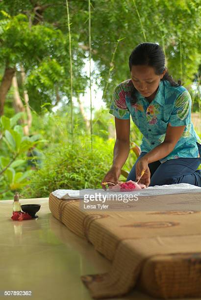 A woman preparing a massage bed at Nusa Lembongan Resort on the small island of Nusa Lembongan off Bali