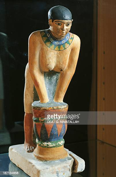 Woman preparing beer painted limestone statue Egyptian Civilisation Old Kingdom Dynasty V Florence Museo Archeologico Nazionale