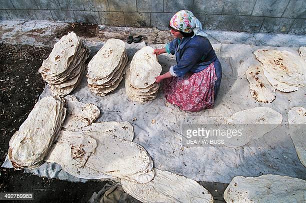 Woman preparing bread, Bjni , Armenia.