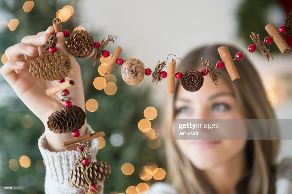 Woman preparing christmas decoration : Stock Photo
