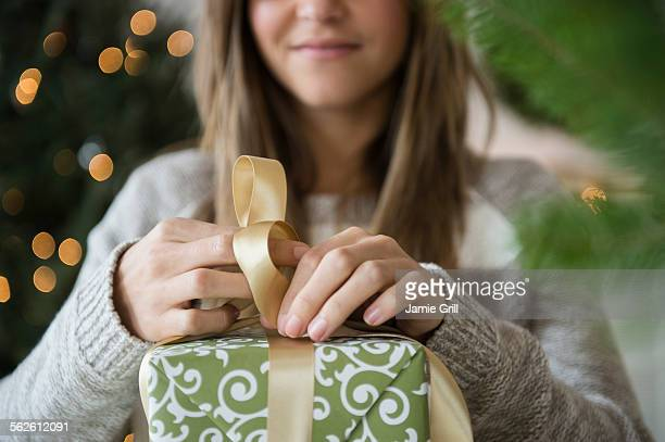 Woman preparing christmas gifts