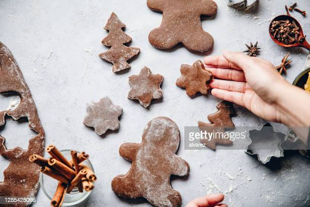 woman preparing christmas gingerbread cookies - gingerbread cookie stock pictures, royalty-free photos & images