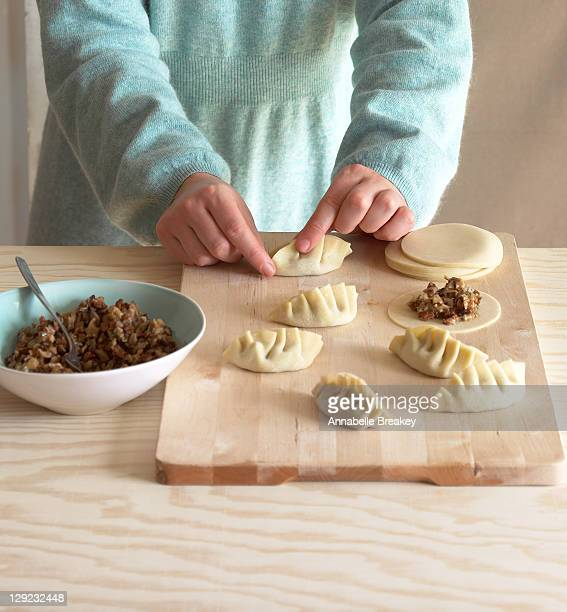 Woman Preparing Dim Sum Pot Sticker Appetizers