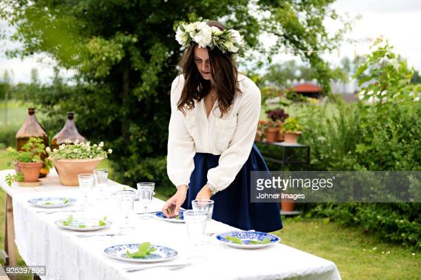 woman preparing dinner party - midsommar stock pictures, royalty-free photos & images