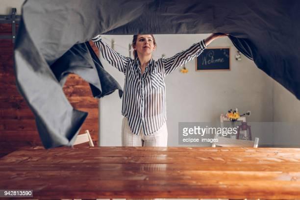 Woman preparing dinner table
