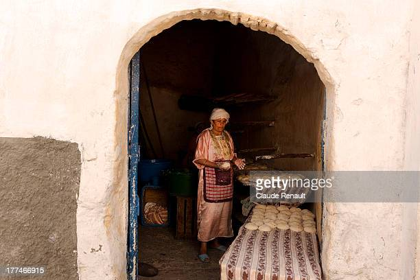 CONTENT] A woman preparing dough in a bakery of Azemmour