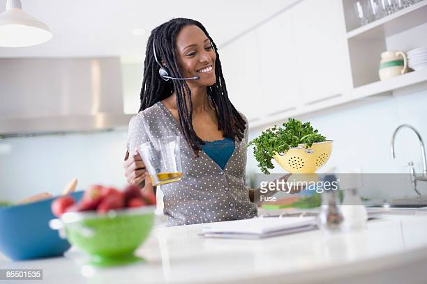Woman Preparing Food and Using Hands Free Headset
