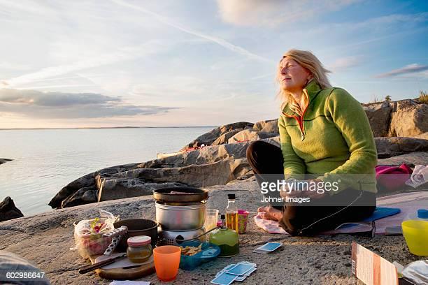 Woman preparing food during camping