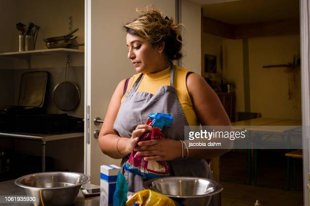woman preparing food for her street food business - vulnerability stock pictures, royalty-free photos & images