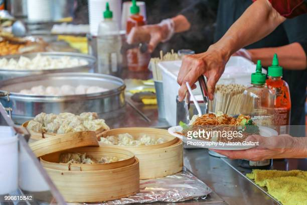 woman preparing food in the richmond night market near vancouver, canada. - richmond british columbia stock photos and pictures