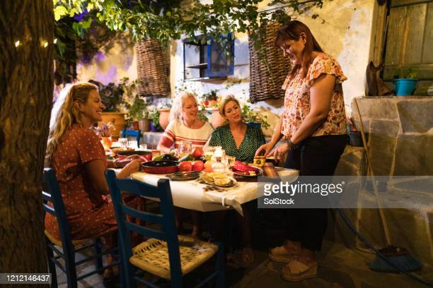 woman preparing food in traditional cooking class - dolmades stock pictures, royalty-free photos & images