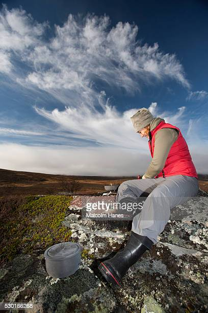 Woman preparing food outdoors