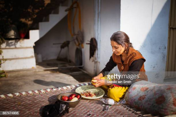 woman preparing food outdoors - punjab pakistan stock photos and pictures