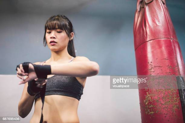 woman preparing for a fight - martial arts stock pictures, royalty-free photos & images