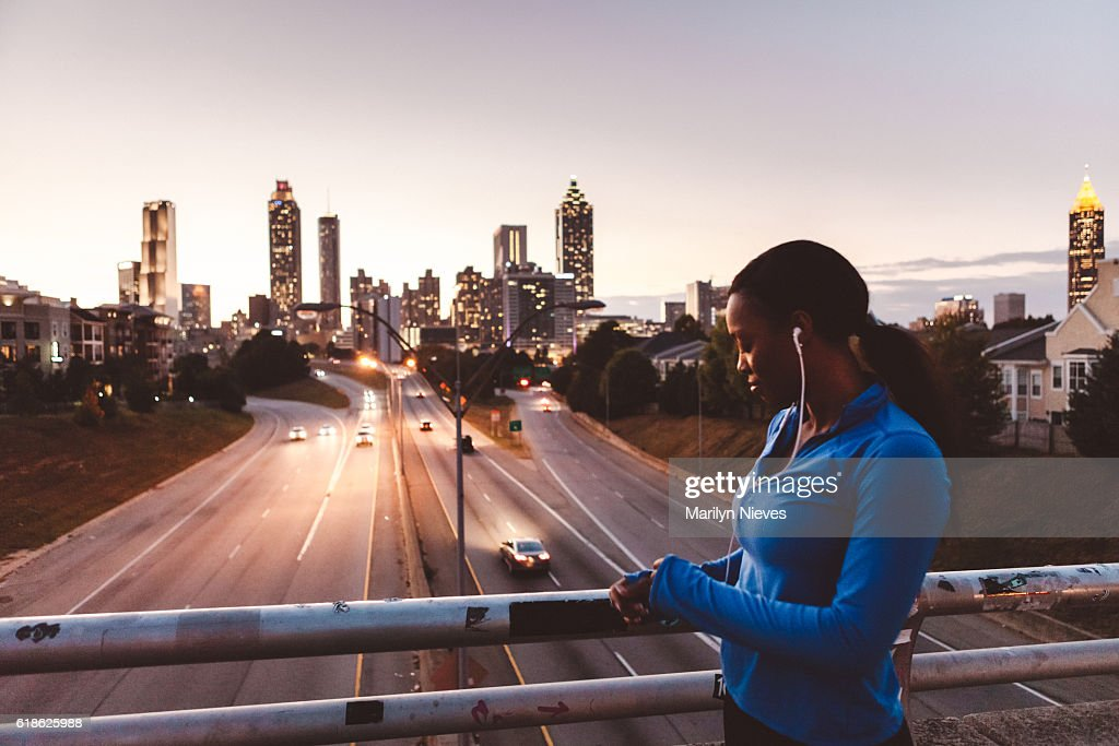 woman preparing for a run in the city : Stock Photo