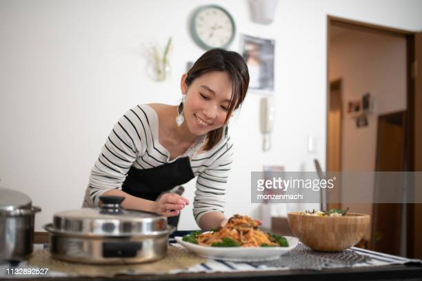 woman preparing for meal at home - homemaker stock pictures, royalty-free photos & images