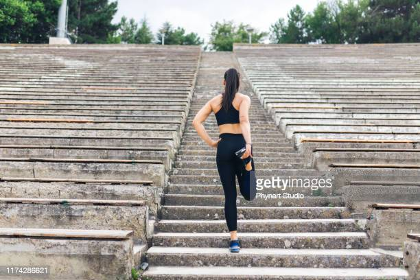 woman preparing for run up the stairs - leggings stock pictures, royalty-free photos & images