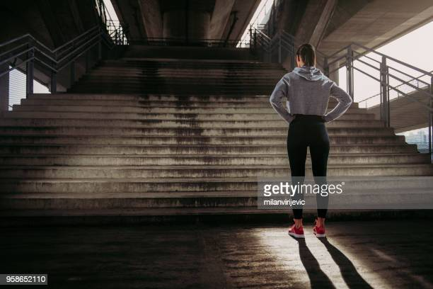 woman preparing for run up the stairs - preparation stock pictures, royalty-free photos & images