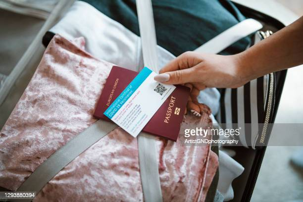 woman preparing for travelling after covid-19 pandemic. - national border stock pictures, royalty-free photos & images