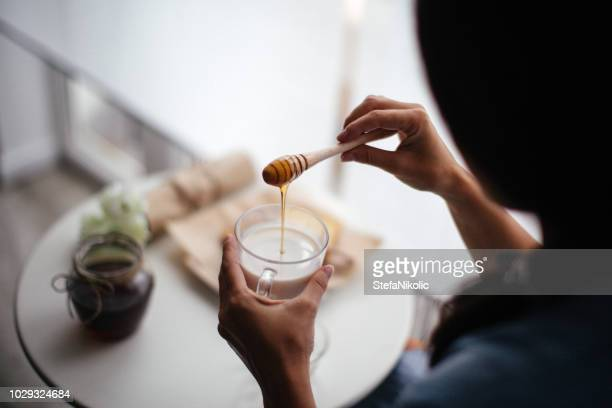 woman preparing healthy breakfast at home - honey stock pictures, royalty-free photos & images