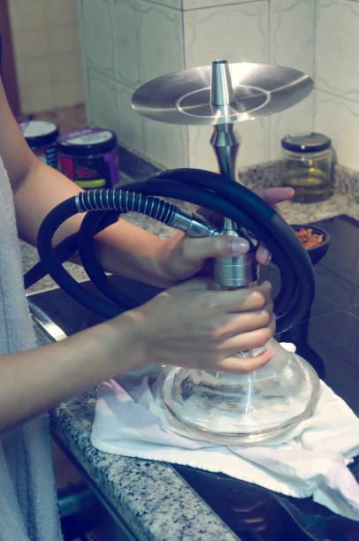 Woman preparing hookah