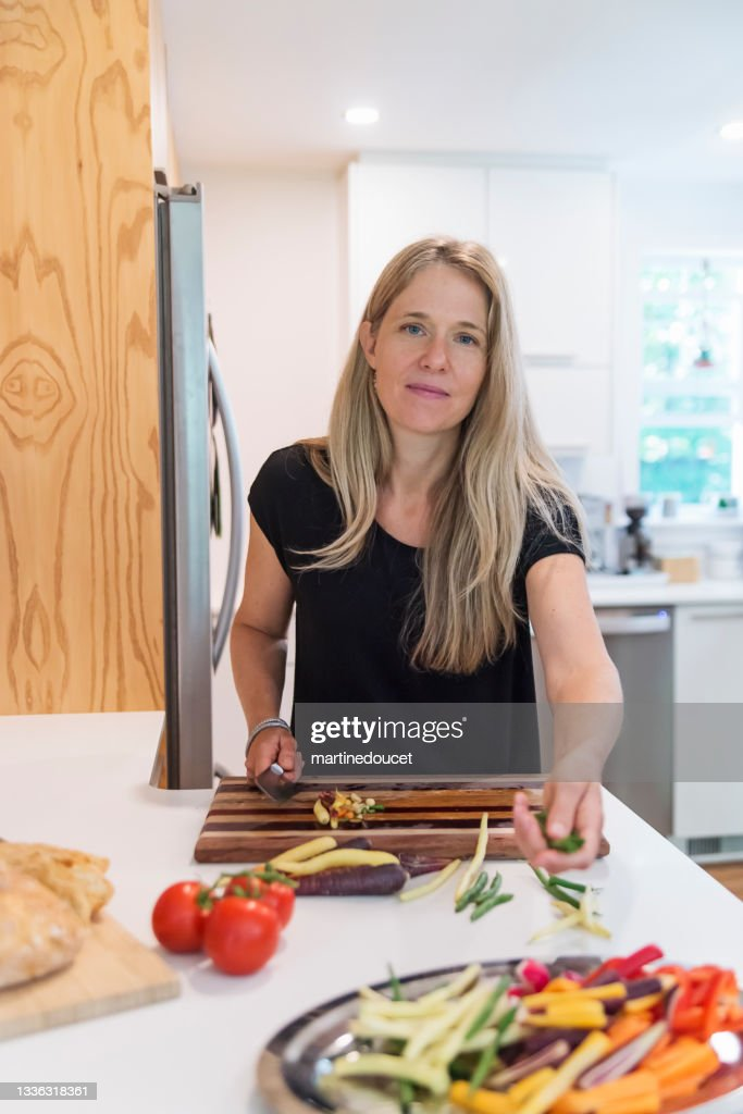 Woman preparing lunch in home kitchen. : Stock Photo