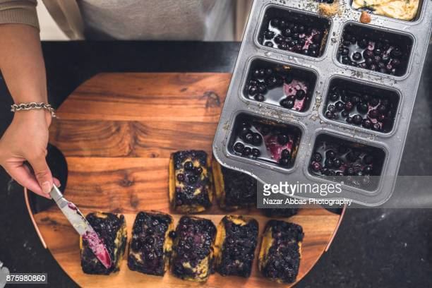 Woman Preparing mini Blueberry cakes.