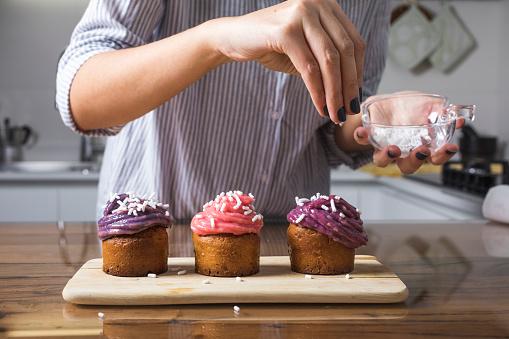 Woman preparing muffins at home - gettyimageskorea