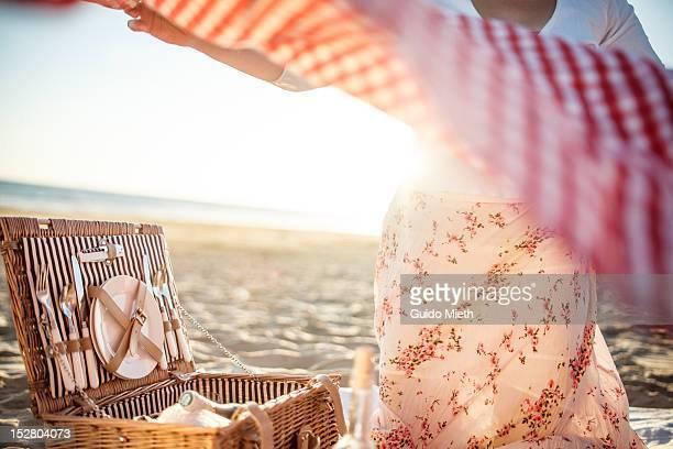 Woman preparing picnic at beach