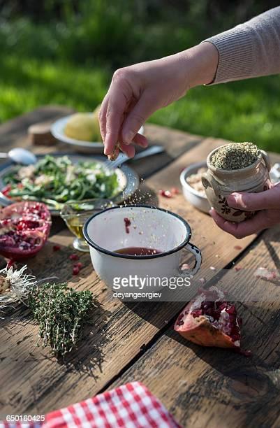 Woman preparing salad dressing