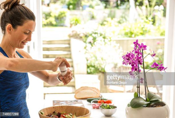 woman preparing salad lunch - one mature woman only stock pictures, royalty-free photos & images