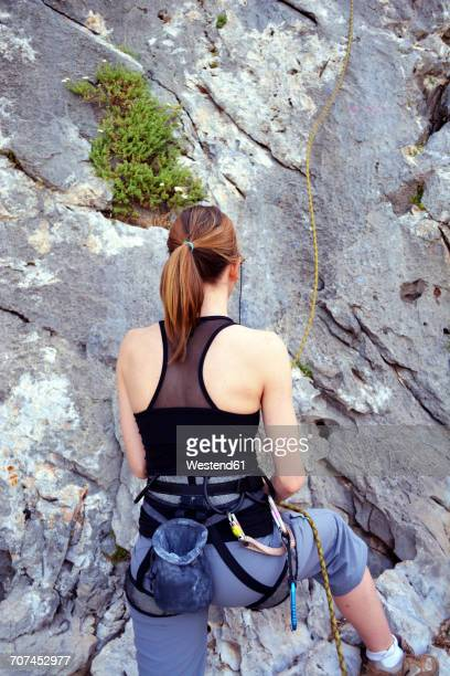 Woman preparing to climb a rock wall
